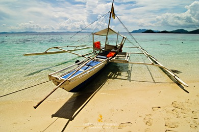 A Boat Docked at the Banol Beach in Coron