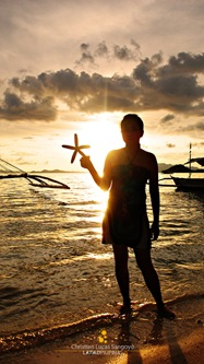 Her Starfish and the Sunset at Coron's Banol Beach