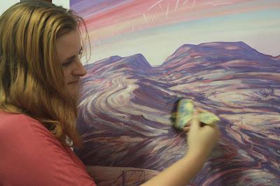 Wendy Grace Allen overworking Helen Stacey's painting.