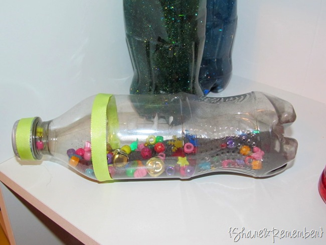 Sensory Bottles sand beads and bells