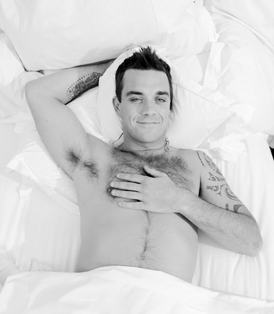 robbie williams in bed showing off his hairy chest
