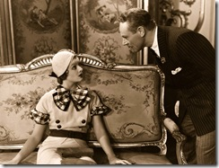 1932: Myrna Loy (1905 - 1993) looks up at Charles Ruggles (1886 - 1970), the American character comedian in a scene from 'Love Me Tonight', directed by Rouben Mamoulian for Paramount.