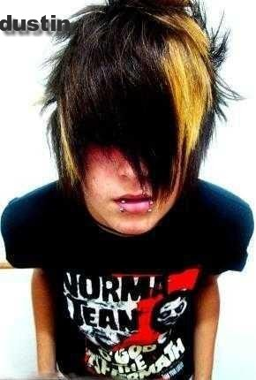 Emo boys hairstyles feature archetypal long bangs, brushed straight and in