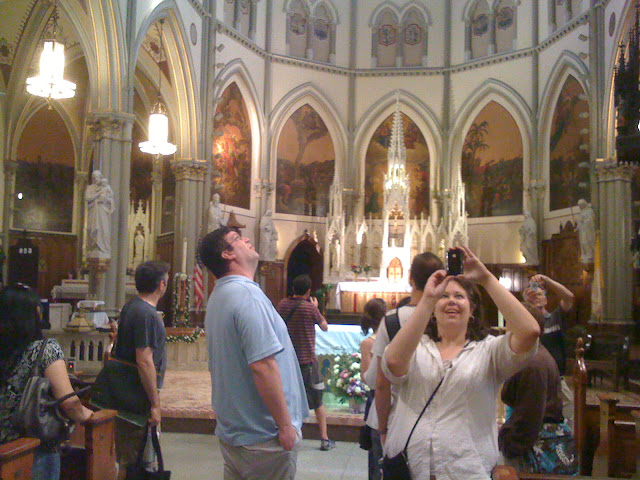 People looking up in awe and taking photographs of a beautiful cathedral-like Gothic church