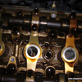 Oil in the spark plug chamber from leaky valve cover gasket