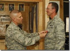 090624-F-0465C-006 Col Kwast Awarding Bronze Star