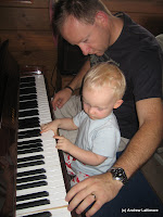 Benjamin and Andrew playing with Grandad George\'s piano.