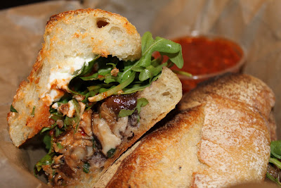 torta - shortribs, caramelized onions, artisan Jack cheese, black ...