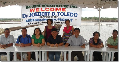 Ms. Betty Lua, AQD Chief Dr. Joebert Toledo, and Mr. Fortunato Sanchez Jr. sign the closure agreement (seated, 3rd to 5th from left, respectively) as witnessed by the Lua family members