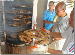 Smoking bangus (in the middle is one of the small-business entrepreneurs)