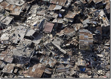 In this photo released by the United Nations, homes affected by an earthquake lay in ruins in Port-au-Prince, Haiti, Wednesday, Jan. 13, 2010. A 7.0-magnitude earthquake struck Haiti Tuesday.
