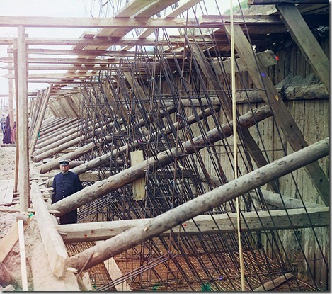 Construction of iron-concrete frames for the lock's walls, Beloomut, Uniformed man posed in framework of lock; 1912 Sergei Mikhailovich Prokudin-Gorskii Collection (Library of Congress).