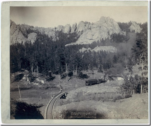 "Title: ""Horse Shoe Curve."" On B[urlington] and M[issouri River] R'y. Buckhorn Mountains in background Bird's-eye view of a train on tracks, just beyond a marked curve. 1891. Repository: Library of Congress Prints and Photographs Division Washington, D.C. 20540"