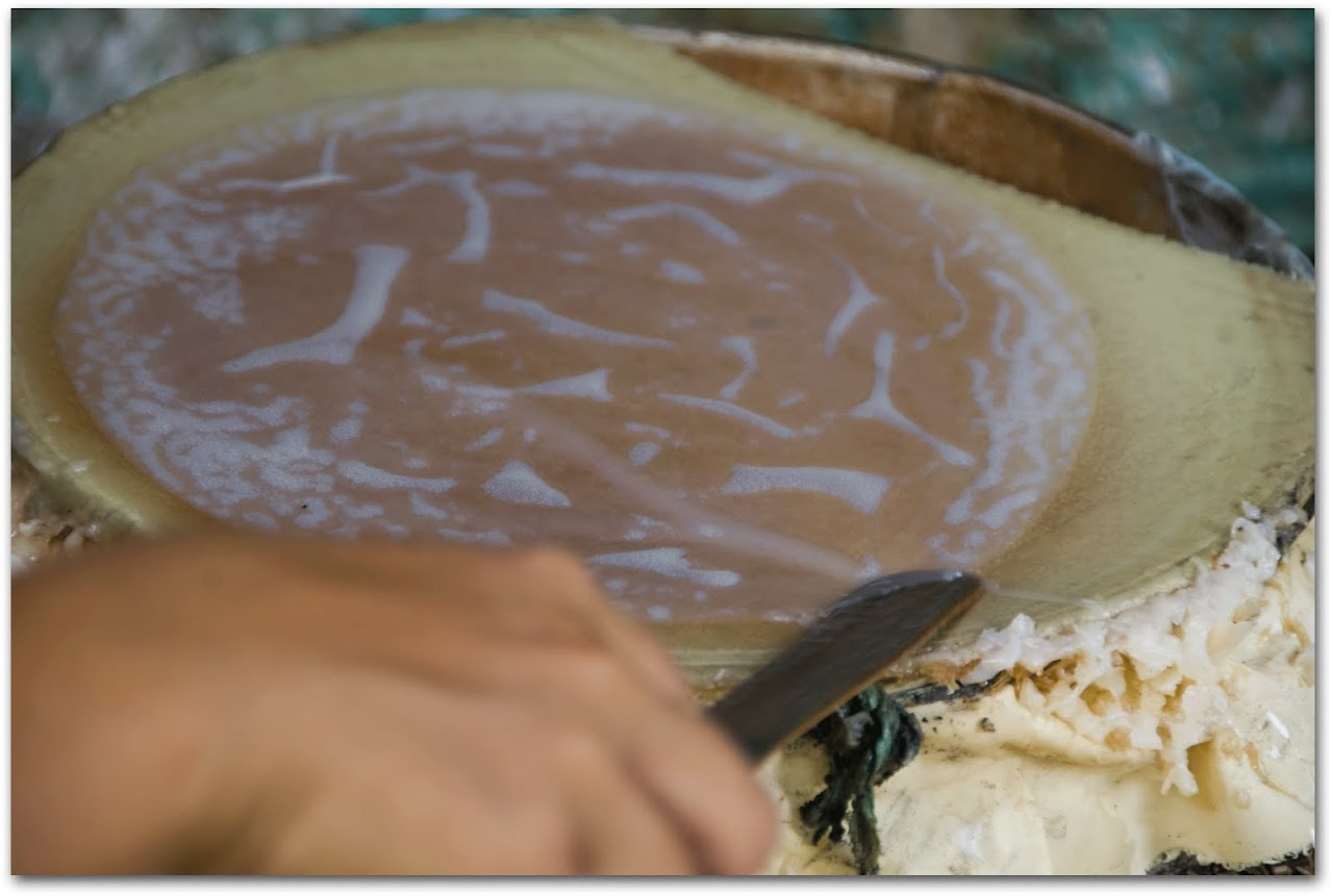 Rice paper roll liquid being cooked on pan