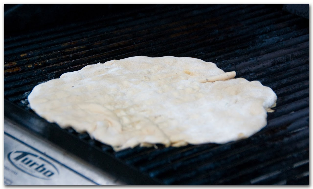 Uncooked crust on grill