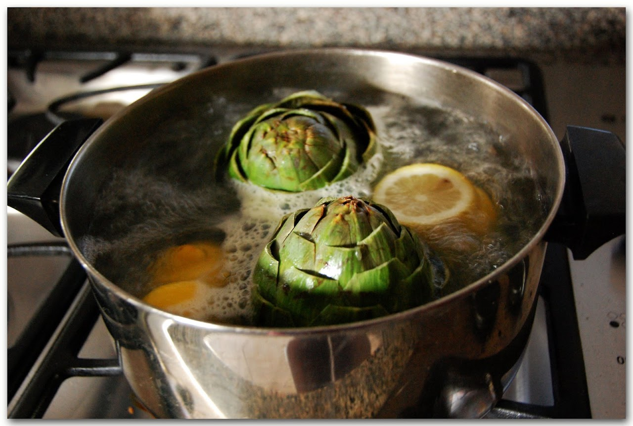 Artichokes boiling in water