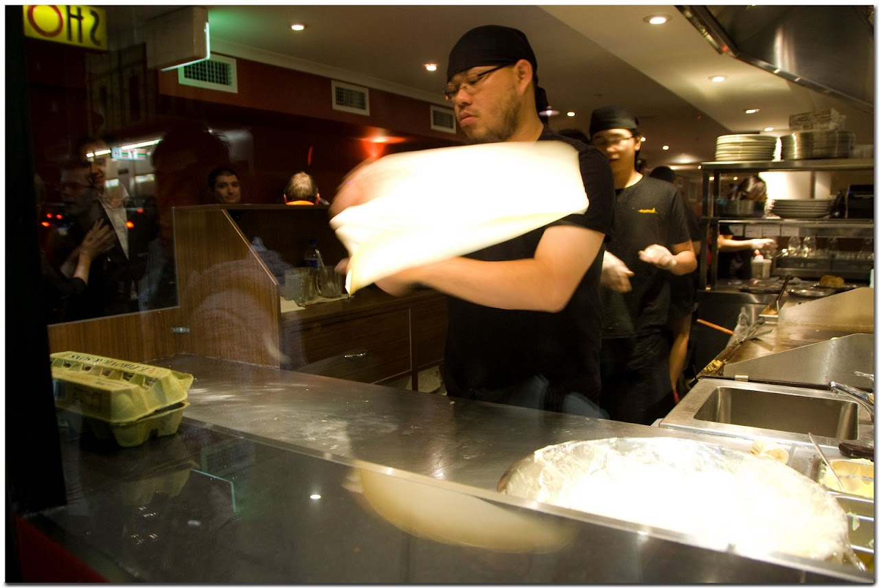 Tossing roti dough
