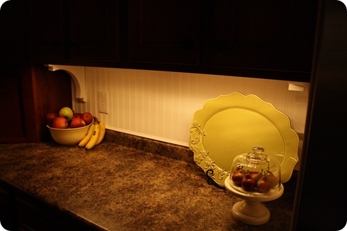mood lighting in the kitchen from thrifty decor chick above cabinet lighting