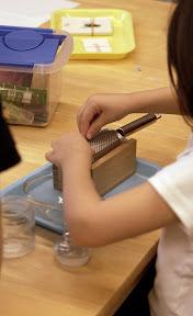 Student using Montessori materials