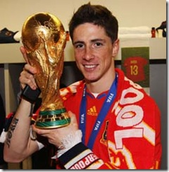 Torres with World Cup trophy