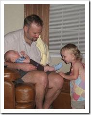 Avery likes to tickle Baby Reid's feet! 5-23-09