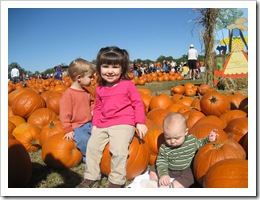 Ethan, Kate & Reid...Kate knows what to do for the camera! 10-24-09