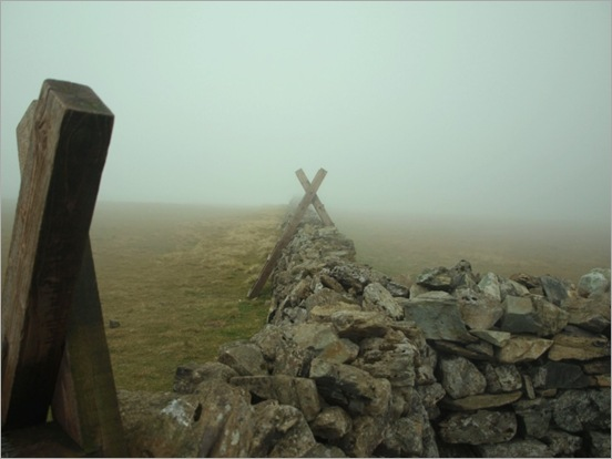 Styles at wall junction on Slieve Muck