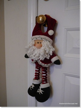 Kid friendly Santa hanging on the doorknob