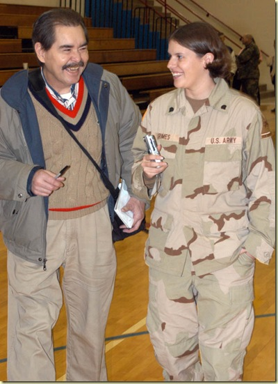 Doug Hunt with Spc. Billie Grimes at Western Boone High School on Jan. 6, 2004. Time magazine named the U.S. military its Person of the Year for 2003 and Grimes was chosen as one of three soldiers to appear on the Person of the Year issue cover. She was a graduate of Western Boone and the whole community turned out to welcome her home from Iraq. Photo by John Flora