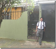 Elder Reyes in front of their house