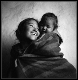First Prize: Devon Cummings cummingsdevon@earthlink.net 495 12th st., #3R Brooklyn, NY 11215 USA 646-207-4951  Title: Madonna and Child Caption: Mother and child in Muktinath, Nepal.
