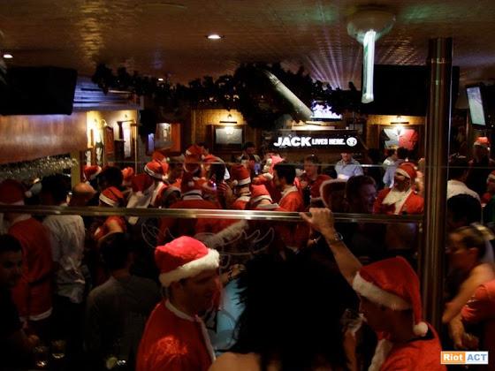 Santas in a bar