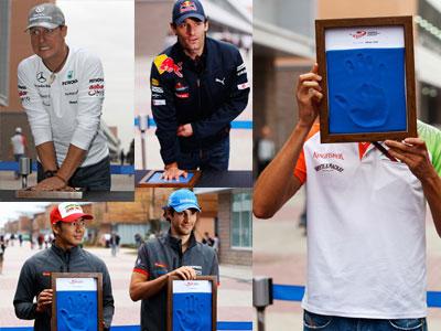 гонщики Формулы-1 оставляют свои отпечатки рук на Гран-при Кореи 2010