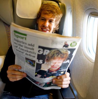 Себастьян Феттель читает газету с собой на обложке