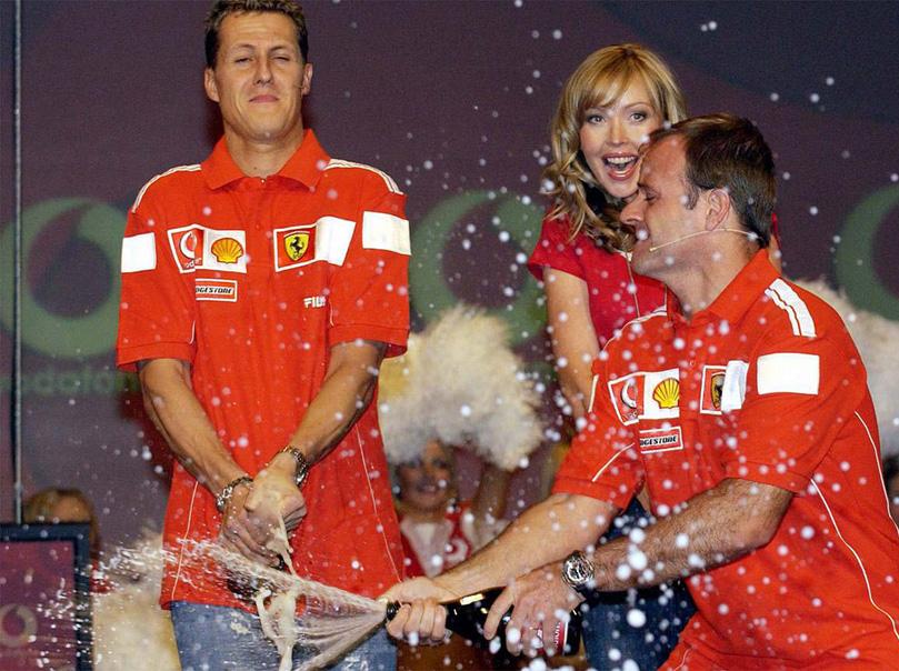 Михаэль Шумахер и Рубенс Баррикелло с шампанским