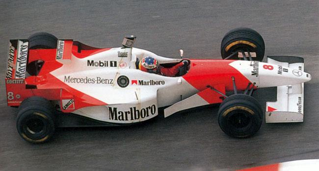 Дэвид Култхард на McLaren Гран-при Монако 1996 в шлеме Михаэля Шумахера