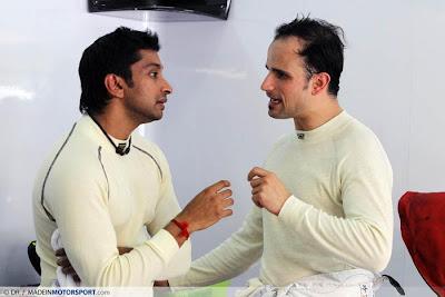Нараин Картикеян и Витантонио Льюцци разговаривают в боксах на Гран-при Малайзии 2011