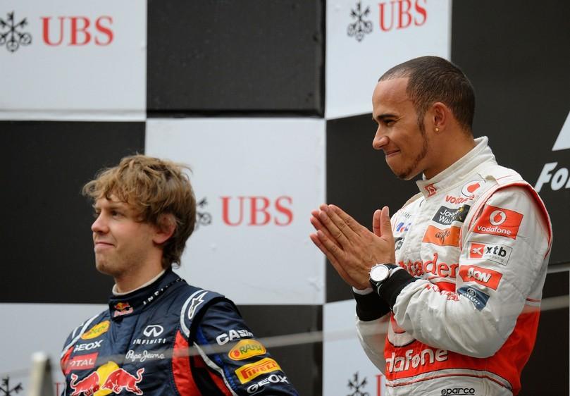 Льюис Хэмилтон и Себастьян Феттель на подиуме Гран-при Китая 2011