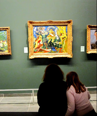 Viewing art in the Musée de l'Orangerie, Paris