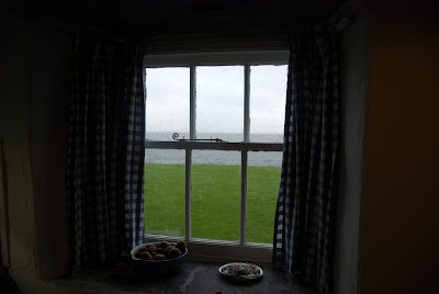 Warm inside during the storm, Pier Cottage