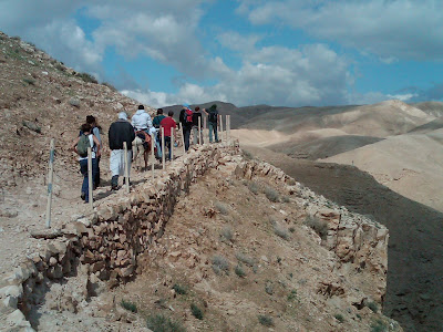 walking in the Wadi Quelt in the Palestinian Territories
