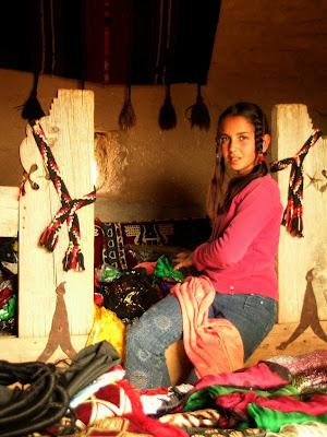 young Turkish girl near the path in Harran making handicrafts