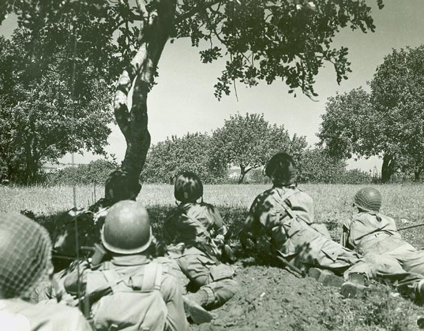 Biazza ridge Sicily Invasion—U.S. paratroopers advancing through the Sicilian countryside after night landing. Gela, Sicily. Photos taken by the US Army Signal Corps during World War II