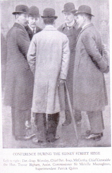 John McCarthy conferring with other senior officers during the Sidney Street siege