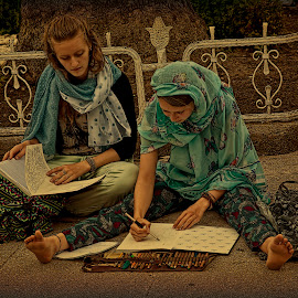 Istanbul. Young artists near the Blue Mosque. by Eugene Goldin - People Street & Candids ( girls, artists, blue mosque, istanbul, turkey )