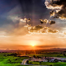 sunset by Mahdi Gh B - Landscapes Sunsets & Sunrises ( clouds, orange, mountain, grass, green, sunlight, sun, city, sky, red, sunset, rise, sunrise, river )