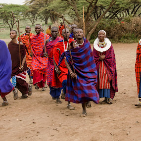 Maasai welcome by Gene Myers - People Group/Corporate ( robes, shotsbygene, colors, tribe, tanzania, women, gene myers, village, warriors, men, welcome, africa, maasai, dance, , Travel, People, Lifestyle, Culture )
