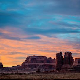 Sunrise in Arches by Valor Alvarado - Landscapes Deserts ( clouds, moab, national park, utah, arches, rock, sunrise, blue, orange. color )