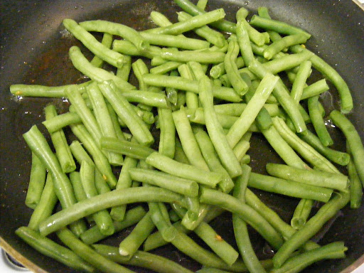 Saute the steamed green beans in bacon drippings.