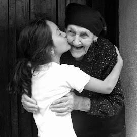 Emotions  by Slobodan Bobo Kovac - People Family ( love, grandchild, kiss, granny, nature, village, black and white, great grandmother, emotions, grandmother,  )